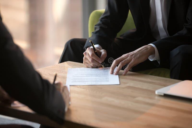 Close up businessmen signing partnership agreement, making legal deal. Close up businessmen signing partnership agreement, business partners making legal deal stock photos