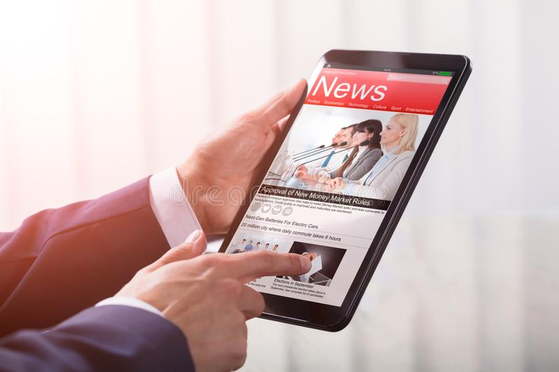 Close-up Of A Businessperson Holding Tablet royalty free stock photos