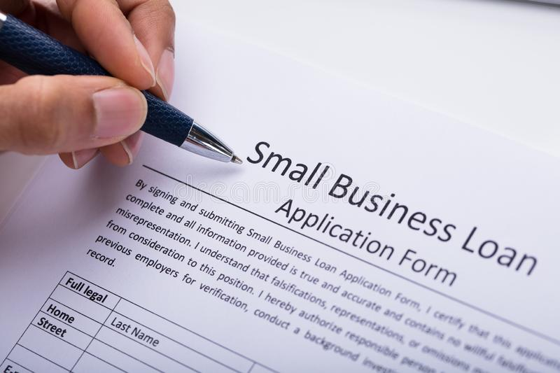 Businessperson Filling Small Business Loan Application Form stock photos