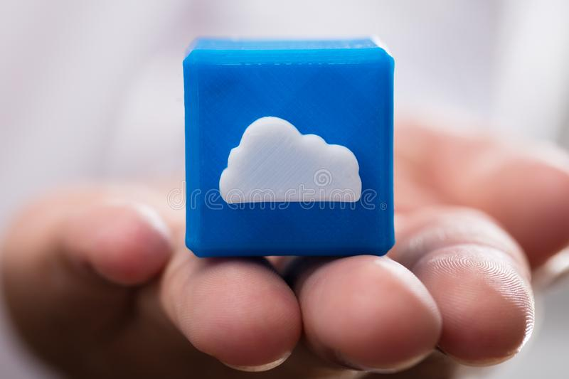Businessperson holding cloud icon cubic block royalty free stock images