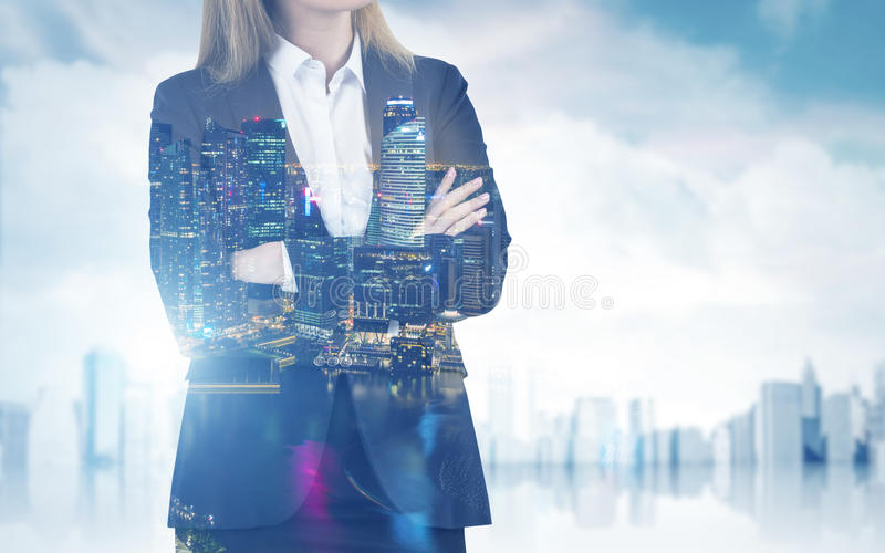 Close up of businesswoman with crossed arms in a city royalty free stock photos