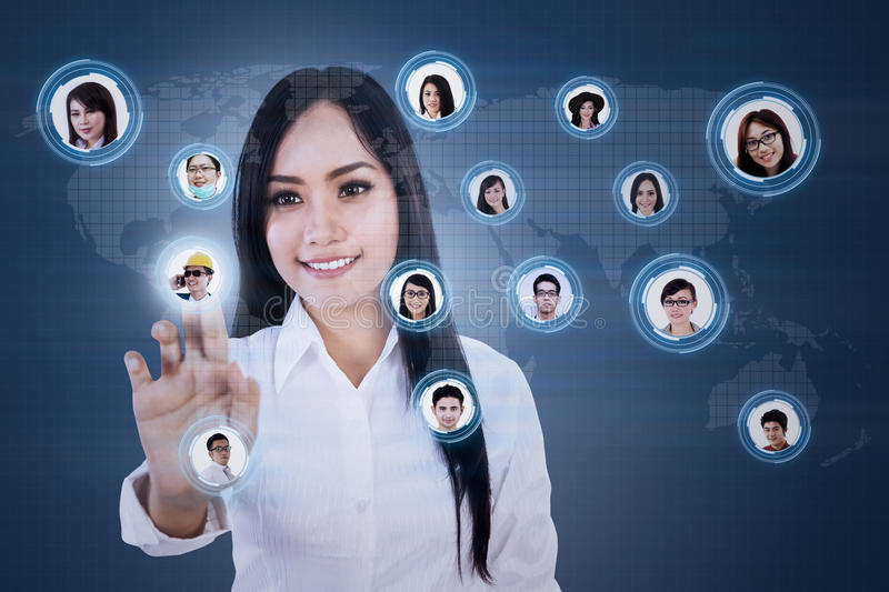 Close-up of businesswoman and digital network connection stock photos