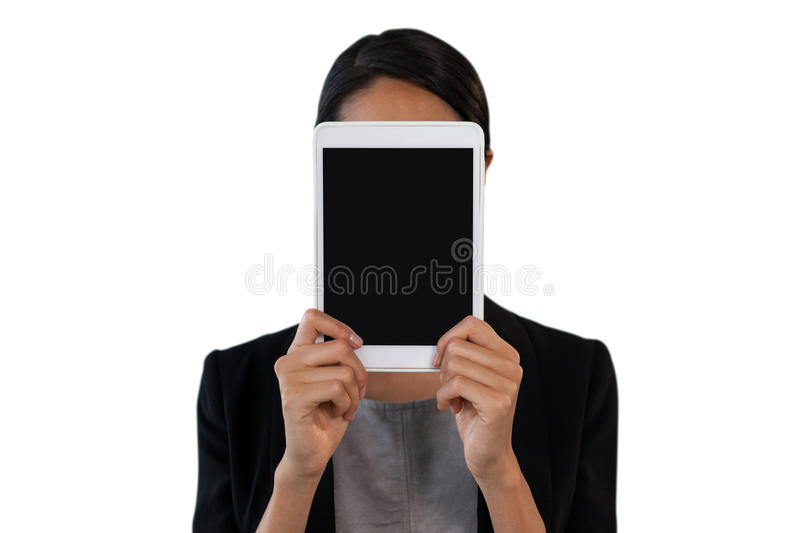 Close up of businesswoman holding tablet computer in front of face royalty free stock image
