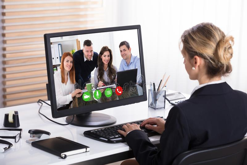 Businesswoman Video Conference With Her Colleagues royalty free stock photo