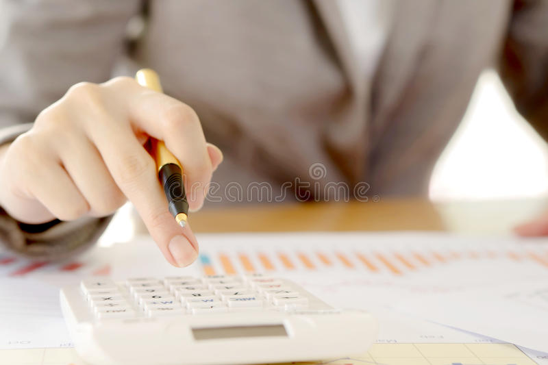 Close up of businesswomen accountant or banker making calculations. Sav stock images
