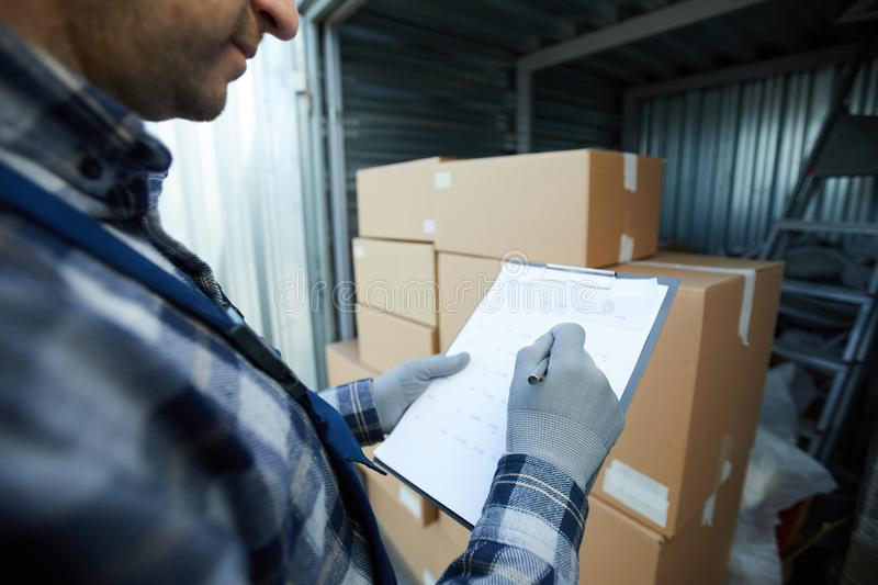 Busy cargo worker analyzing data royalty free stock image