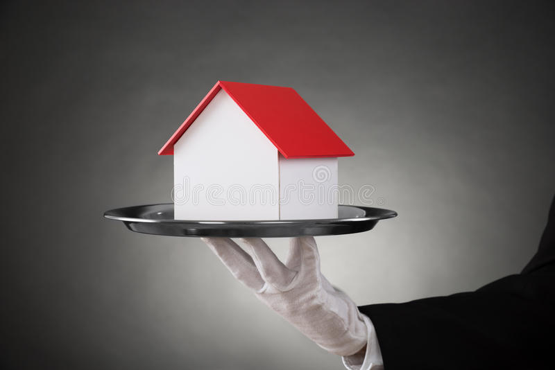 Close-up Of Butler With House Model stock photography