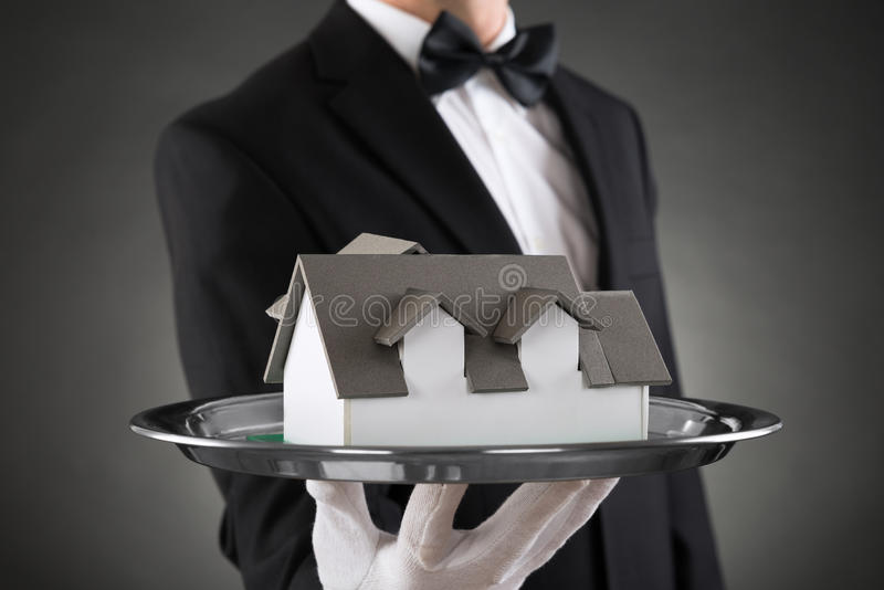 Close-up Of Butler With House Model stock photos