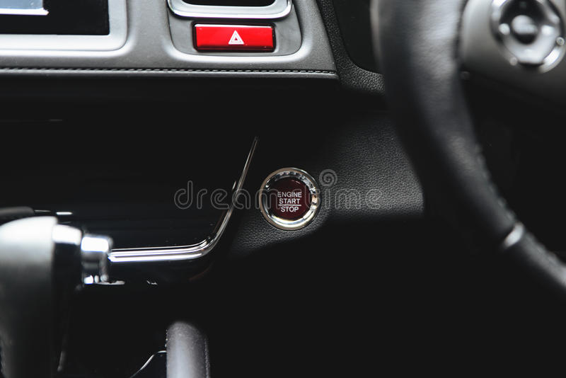 Close up button functions car engine start and stop in motor vehicle for pre start checklist concept.  royalty free stock photography