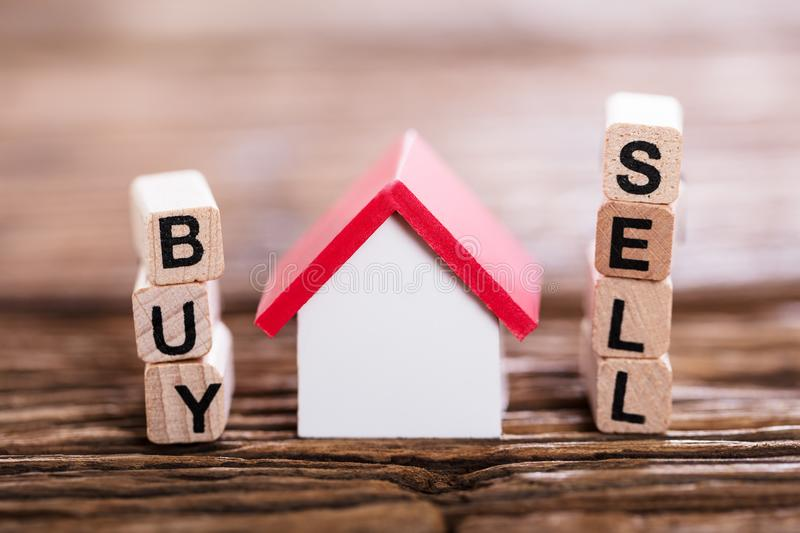 Buy Or Sell Option With Small House Model stock image