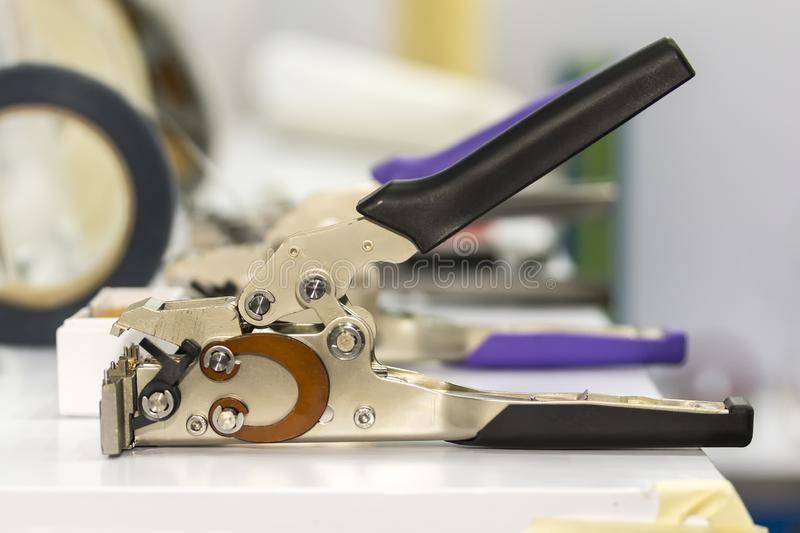 Close up cable cutter or cable stripper equipment for electrical industrial work stock photo