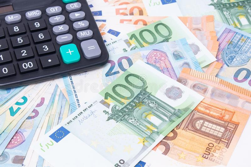 Calculator on Euro banknotes. Euro money bills to pay. Finances and budget concept. Tax and money royalty free stock images