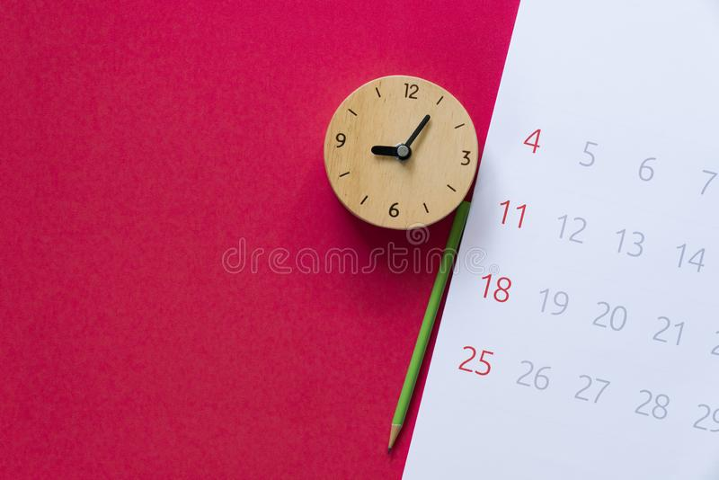 Close up of calendar, clock and pencil on the red table background. Planning for business meeting or travel planning concept stock images