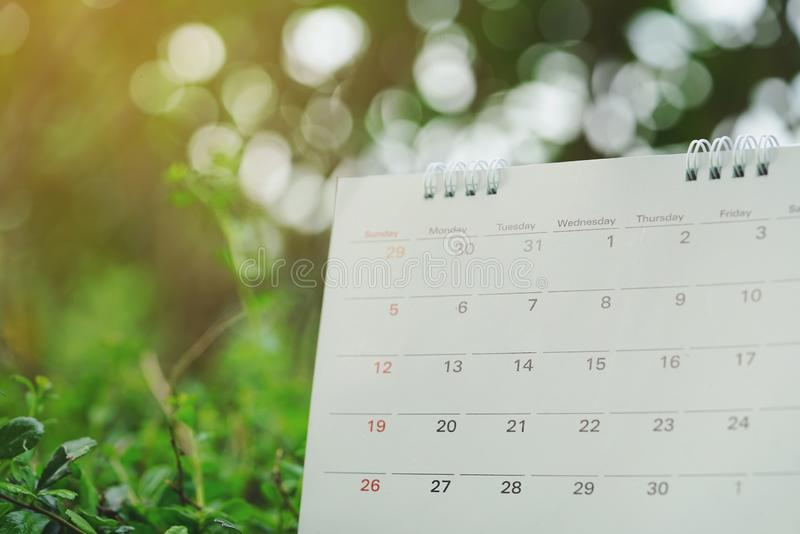 Close up of calendar on green nature background with copy space. Planning for business meeting or travel planning concept royalty free stock images