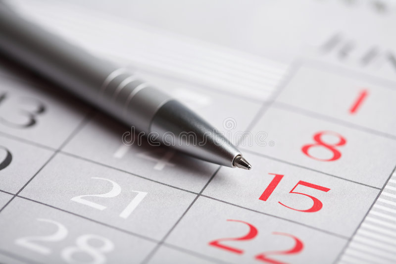Close-up of calendar page. And pen stock images