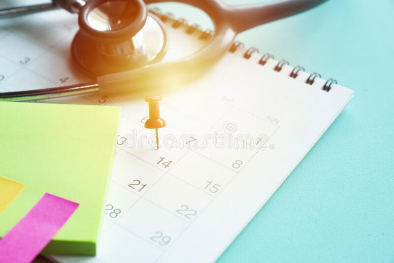 Calendar and stethoscope for Covid-19, Corona Virus epidemic worldwide that people must do social distancing for 14 royalty free stock images