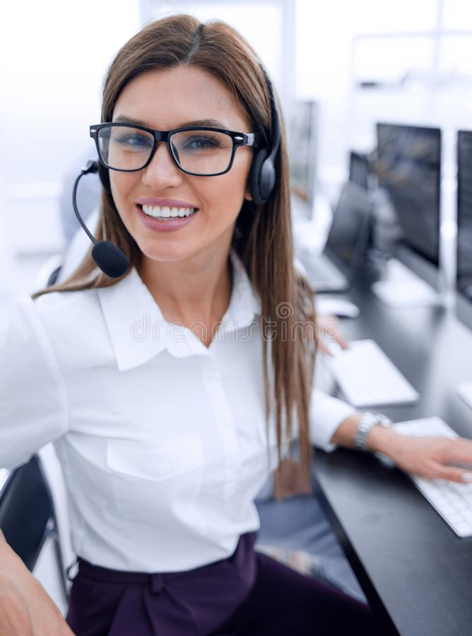Close up. call center employee sitting at his Desk. The concept of professionalism royalty free stock images