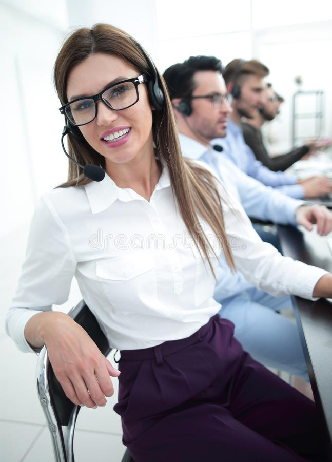 Close up. call center employee sitting at his Desk. The concept of professionalism royalty free stock image