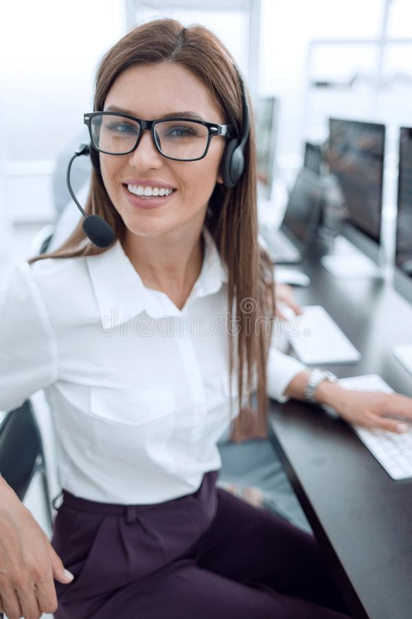 Close up. call center employee sitting at his Desk. The concept of professionalism stock images