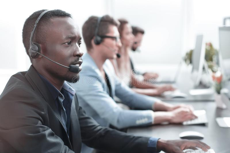 Close up.call center operator on the background of colleagues royalty free stock photos