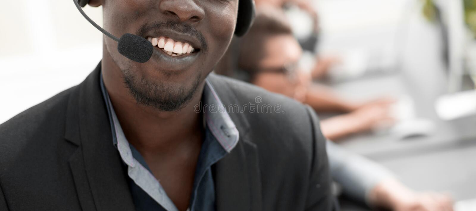 Close up.call center operator on blurred background stock photography