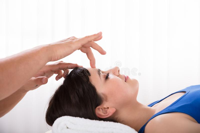 Calm Woman Receiving Reiki Treatment stock photography