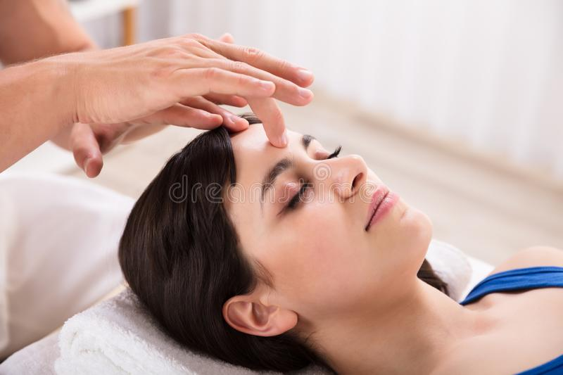 Calm Woman Receiving Reiki Treatment royalty free stock image