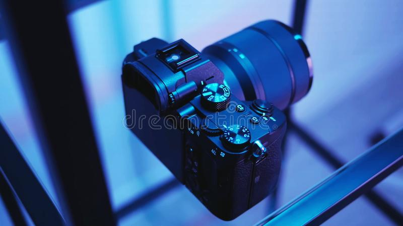 Close-up camera, rear view. The camera in blue, close-up, on a mirror table royalty free stock image