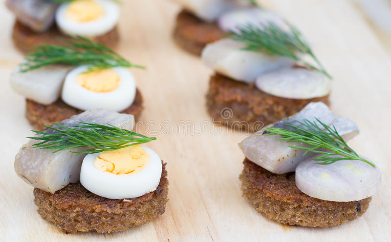 Close-up canapes with herring stock images