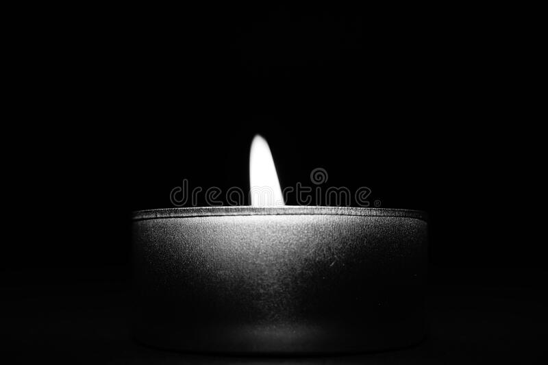 Close-up of Candle over Black Background royalty free stock image