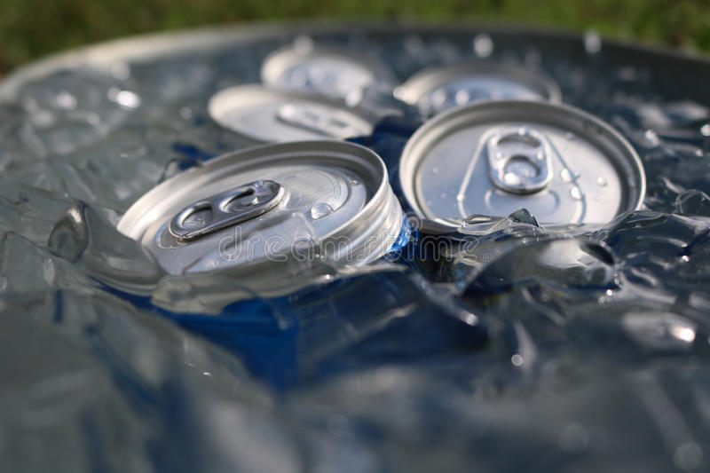 Close up of cans in ice stock photography
