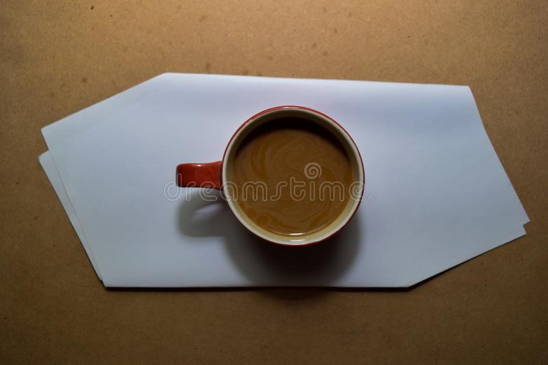 Close up cappuccino in red glass  on wooden table royalty free stock photos