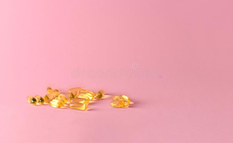 Close up capsules of fish fat oil in the heart shape, omega 3 stock images