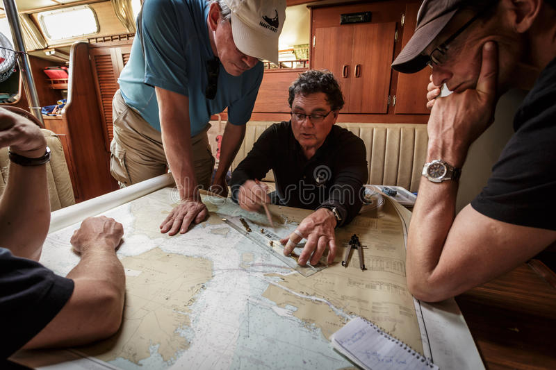 Close-up of captain charting course for sail in the Bay royalty free stock photos