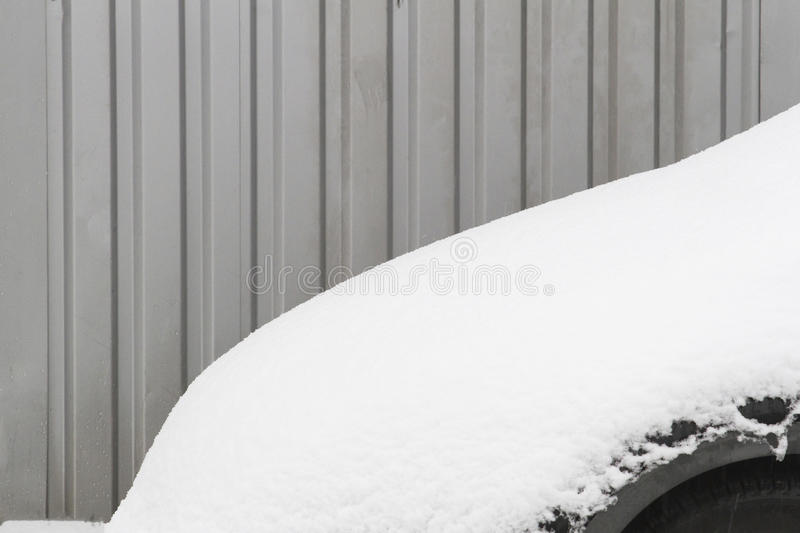 Close up of a car covered in snow after snowfall. Copy space for text. Close up of a car covered in snow after snowfall in winter. Copy space for text royalty free stock photo