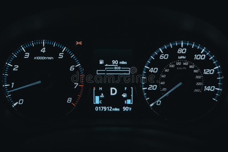 Close up of car dashboard with speedometer and odometer with night lights. SUV Cars dashboard royalty free stock image