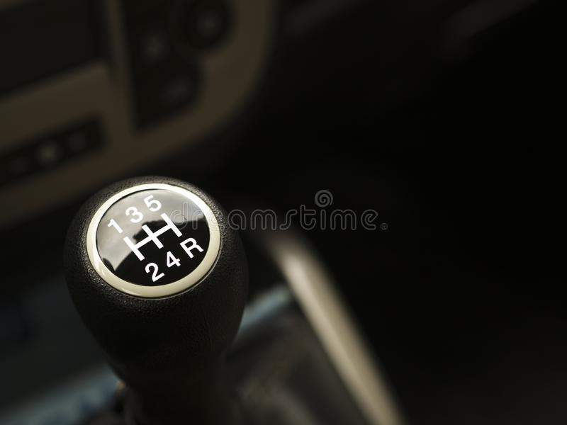 Close-up car interior manual gear lever. signs and figures on the gear lever.  royalty free stock photos