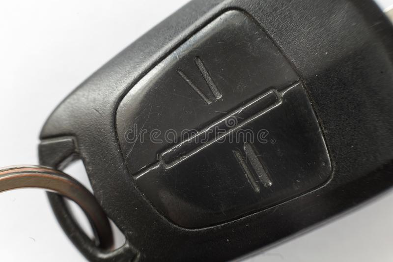 Close-up of car key with remote control buttons on white background. Vehicle lock and keys design, security and transportation stock photos