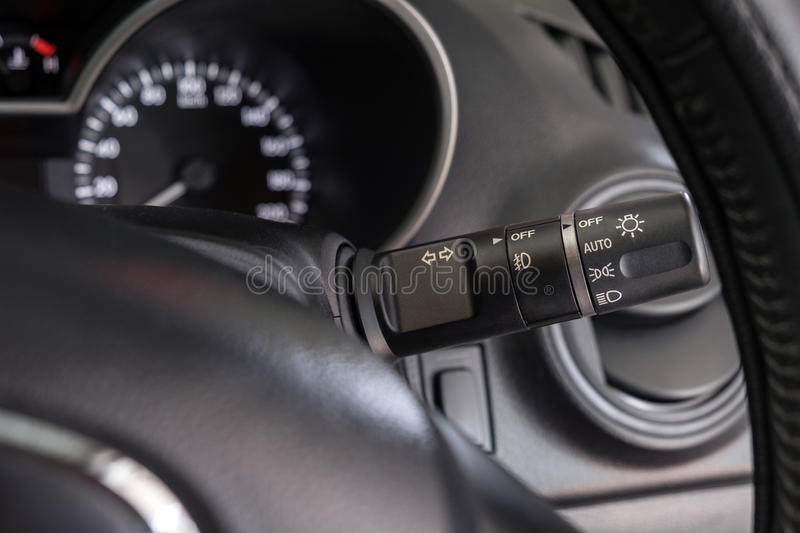 Close up car light switch control stock images