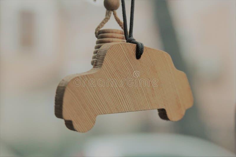 Close-up of wood car-shaped car freshener. Close-up of car-shaped wood car freshener royalty free stock image