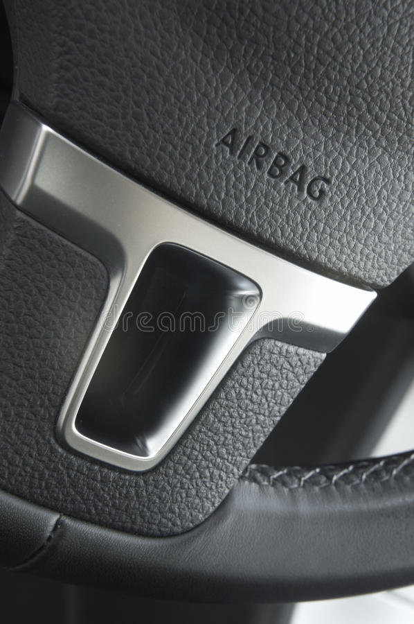 Close up of a car steering wheel airbag royalty free stock images