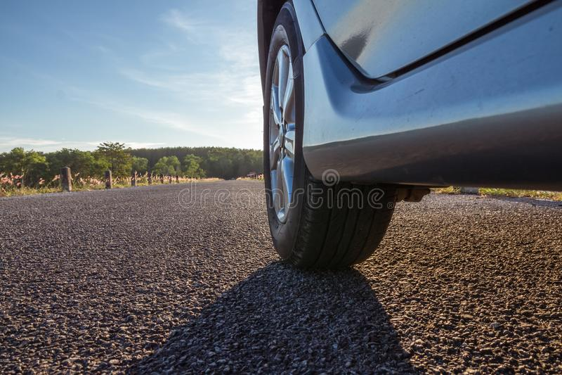 Close up of car wheels on asphalt road royalty free stock photo