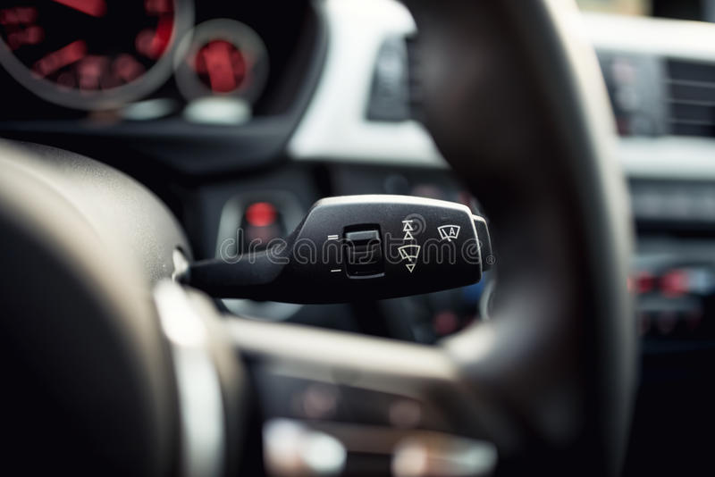 Close-up of car wipers control - modern car interior details, cockpit background stock photos