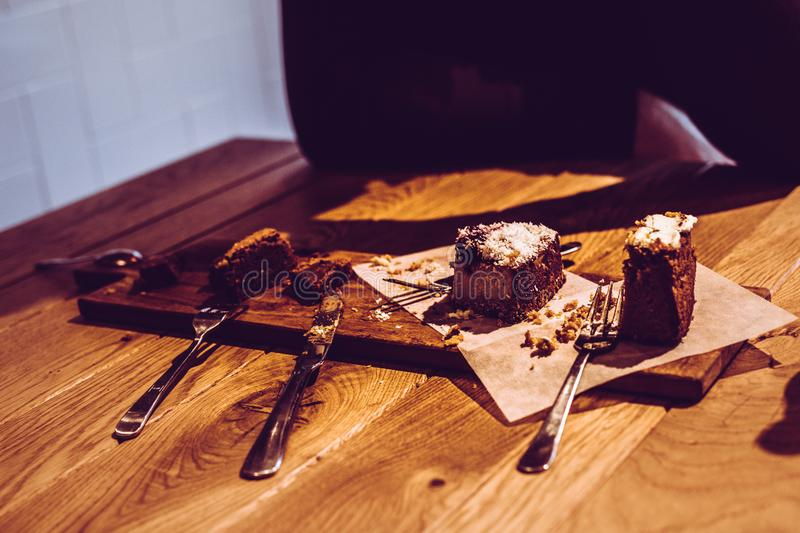 Half-eaten slices of pie with crumbs and forks on table royalty free stock images
