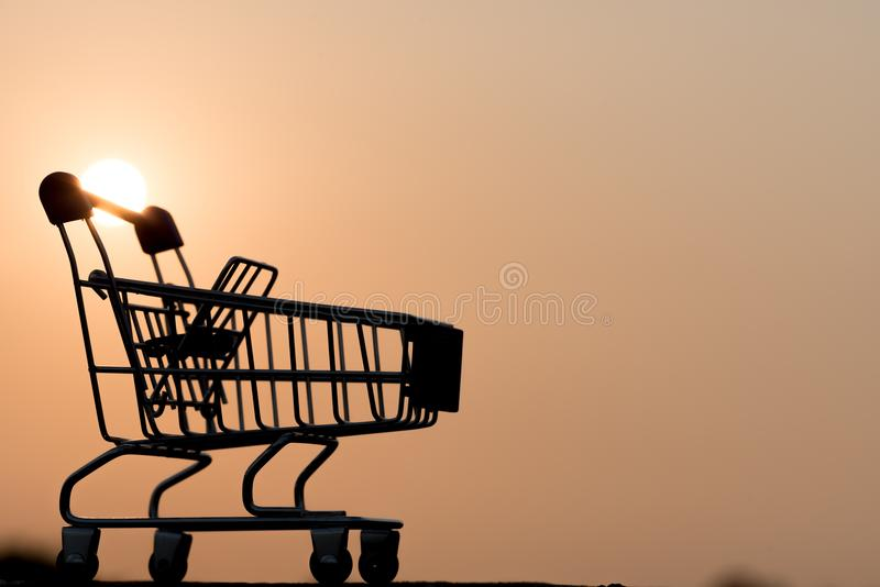 Close up of Cart on keyboard computer with tablet background Online shopping royalty free stock images
