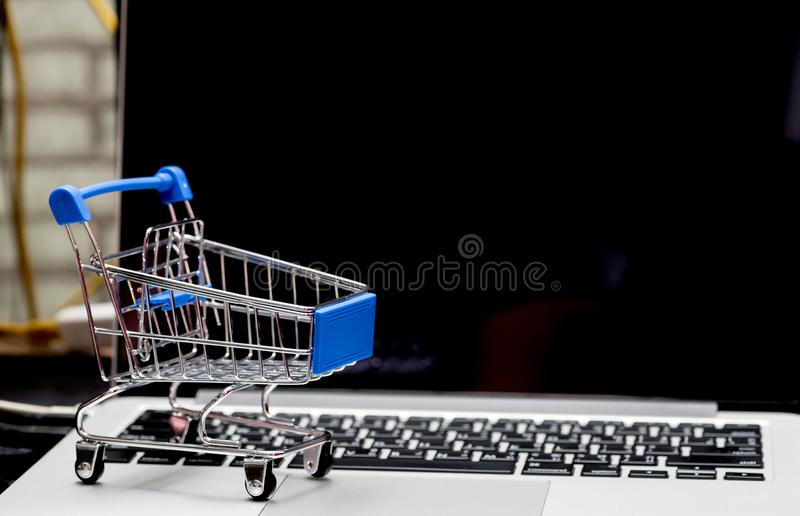 Close up of Cart on keyboard computer with tablet background Online shopping stock images