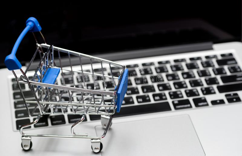 Close up of Cart on keyboard computer with tablet background Online shopping royalty free stock photos