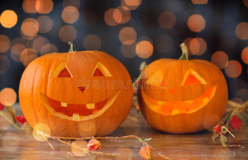 Close up of carved halloween pumpkins on table stock photo