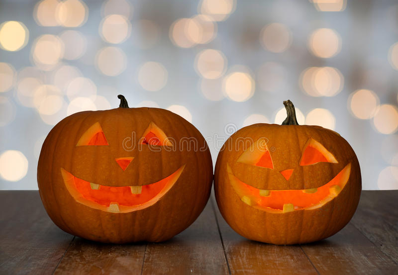 Close up of carved halloween pumpkins on table stock photography