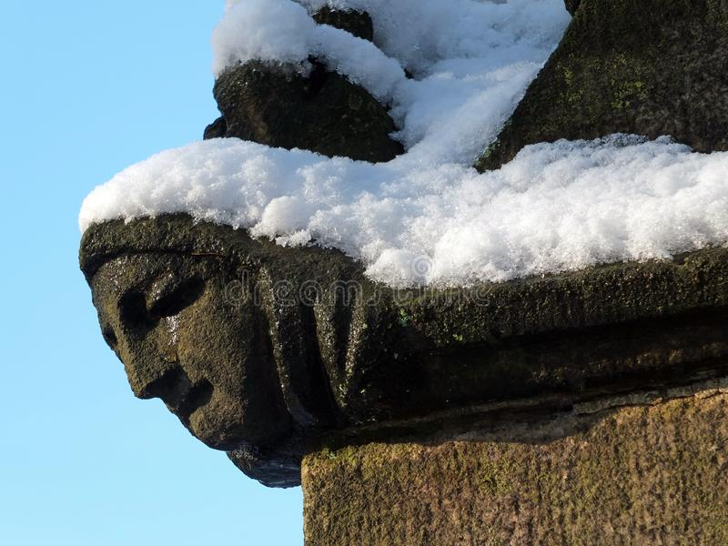 Close up of the carving of a womans face in profile on the corner of the ancient ruined medieval church in heptonstall. A close up of the carving of a womans stock images